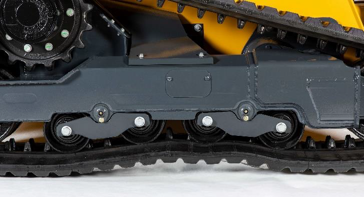 Bogie rollers in the undercarriage oscillate over uneven terrain and prevent the machine from rocking back and forth.